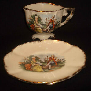 Vintage Ceramic Porcelain Oval Colonial Couple Figural Footed Cup & Saucer Set