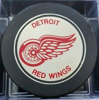 1970s VINTAGE DETROIT RED WINGS  OLD SLUG CANADA HOCKEY PUCK hole in backside