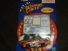 2001 tony stewart 20 home depot 1 64th scale diecast/with worn jersey card