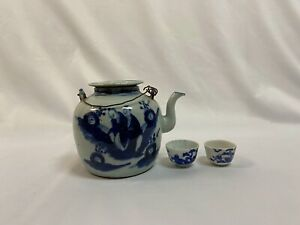 Chinese blue on white antique porcelain teapot with two cups.