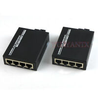 1 Pair 10/100/1000Mbps Fiber Optic Ethernet Media Converter Gigabit 4 RJ45 1 SC