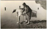 Well Dressed Woman and Girl Digging Clams Vintage Fishing Real Photo Postcard