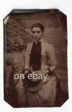 More details for victorian tintype sad young lady unsmiling holding hat - cliffs sea backdrop