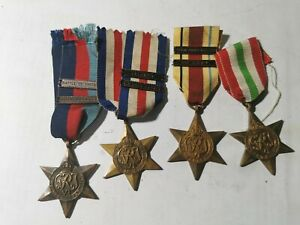 WWII four British medals The star battle of Britain clasp France and Germany