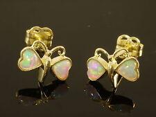 Echtschmuck aus Gelbgold mit Opal-Hauptstein und Cabochon-Schliffform