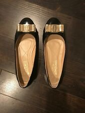Ferragamo flats 7, Gently Used, black patent leather, gold bow