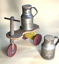 Two Antique Tin Cream Cans and An Unpleasantly Folky Doll Tricycle