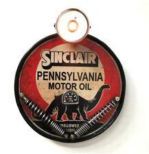 Sinclair motor oil company dinosaur headlight wall sign