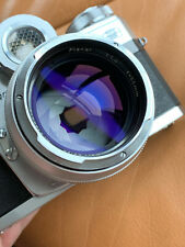 Contarex Bullseye with Carl Zeiss Planar 55mm 1.4 with hood and hard shell