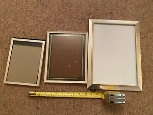 3 silver and white picture frames