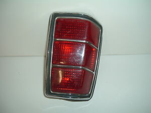1993 Mazda Tail Light Housing, Lens, Chrome Trim Ring, Plug & Gasket