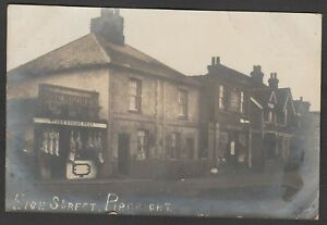 Postcard Pirbright nr Woking shop front of butcher O E Moore post office 1903 RP