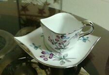 Hand Painted Ucagco China Miniature Teacup & Saucer Set W/ Floral & Silver Trim
