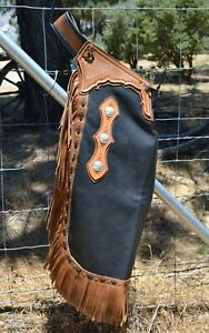 Black Body Chinks with Russet Basket Tooled Yoke and Tan Fringe, Silver Conchos