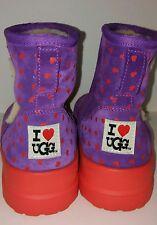 I love ugg boots size 6 purple with orange hearts