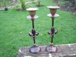 Pair of Brass Candlesticks with Fleur-De-Lis design.