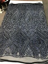 NAVY BLUE SEQUIN DIAMOND DESIGN EMBROIDERY ON A 4 WAY STRETCH MESH-SOLD BY YARD.