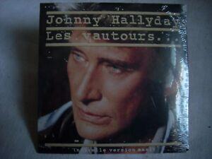 CD single Johnny Hallyday LES VAUTOURS-RIEN A JETER-TESTAMENT D'UN POETE-Neuf