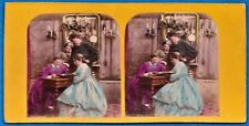 tinted stereoview photo family looking at photographic album foto stereo ca 1865