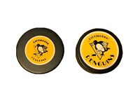 2 Vintage Pittsburgh Penguins NHL General Tire In Glas Co Hockey Puck Trench MFG