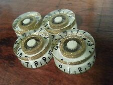 4 Guitar speed volume/tone knobs. Glow In The Dark / Gold Flake..   JAT