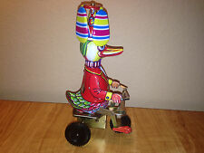 Metal Wind Up Toy Duck on Tricycle Spinning Hat Movement China