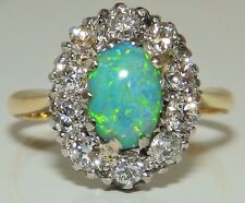 A FINE VINTAGE 18CT YELLOW GOLD CABOCHON OPAL  0.6CT DIAMOND CLUSTER  RING