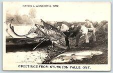 Postcard Canada Ontario Sturgeon Falls Men Riding Exaggeration Fish RPPC F01