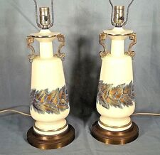 PAIR OF MID CENTURY CLASSICAL DOUBLE HANDLED CERAMIC URN LAMPS WITH GILT LEAVES