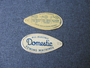 2  Vintage All Electric Domestic Sewing Machine ADV painted tin needle threaders