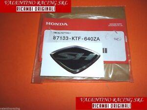 ADESIVO SH SCUDETTO GRIGLIA ANTERIORE SCUDO ORIG HONDA SH 125 I SH 150 2005>2008