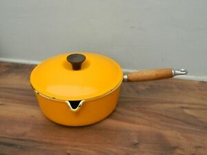 le creuset cast iron saucepan and lid  in light orange  finish  size 22