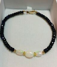 Ethiopian fire opal 6mm oval 7cts Sapphire 14k gold bracelet