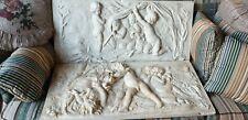 Paire de bas reliefs en platre anciens