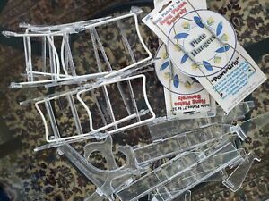 Lot of 14 Assorted plastic and Metal Spring Plate Holders & Plate Hangers