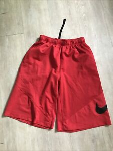Nike Dri Fit boys L large red / black athletic shorts.