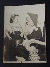 YOUNG GIRL STANDING NEXT TO SANTA SITTING IN A CHAIR Vtg 1947 PHOTO