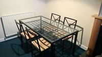 Glass and black metal dining table and 4 chairs, Ikea (Granas)