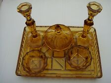 VINTAGE RETRO ART DECO AMBER GLASS DRESSING TABLE SET WITH CANDLESTICKS.