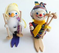 Vintage 2 Steinbach Carved Wood Snowman Girl Skiing Christmas Ornaments Germany