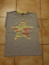 T-shirt pour fille en 14 ans en TBE