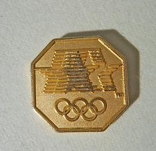Olympic PIN Beautiful GOLD Octagon w/ Stars in Motion & Rings Logo Lapel Pin