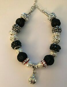 Handmade bracelet with Silver beads and rhinestones, black beads, ladybug