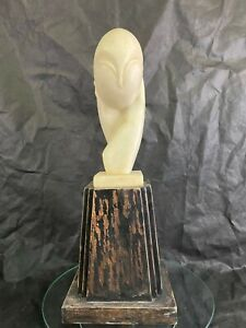 Beautiful abstract marble sculpture on wooden base by Constantin Brancusi