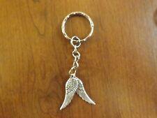 porte clés argenté 2 ailes d'ange 30x10mm