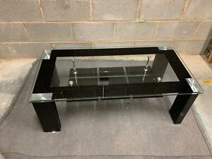 GLASS COFFEE TABLE WITH MAGAZINE RACK