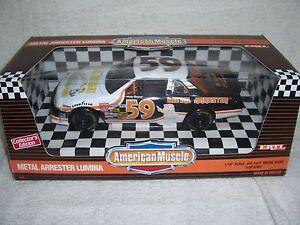 1/18 #59 ANDY BELMONT 1995 METAL ARRESTER LUMINA NASCAR DIECAST CAR-MIB