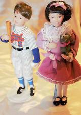 Porcelain Dolls set boy grand slammer and girl with cat