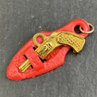 VINTAGE EARLY PLASTIC CHARM REMOVABLE GUN PISTOL IN RED HOLSTER