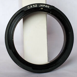 Unbranded metal reverse adapter for Canon FD and lenses with 52mm thread.
